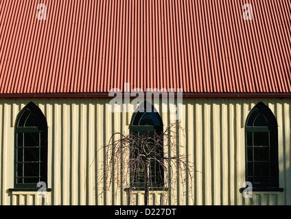 TOWAMBA, Australia - A corrugated iron school house in Towamba, New South Wales, Australia, with strong vertical - Stock Image
