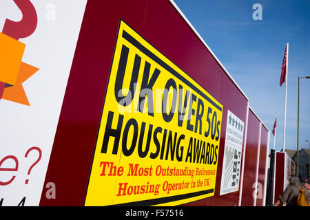 Billboard promoting UK over 50's Housing Awards on new development - Stock Image
