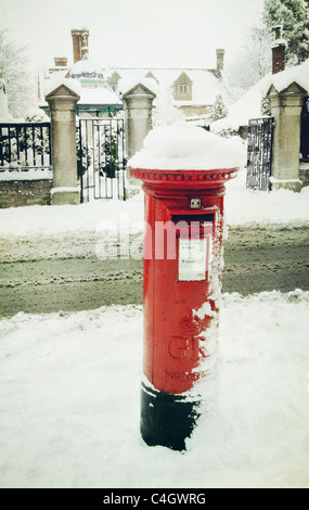 post box in the snow - Stock Image