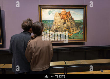 Kunsthistorisches Museum Vienna, rear view of a young couple looking at The Tower Of Babel by Bruegel inside the Kunsthistorisches Museum, Austria. - Stock Image