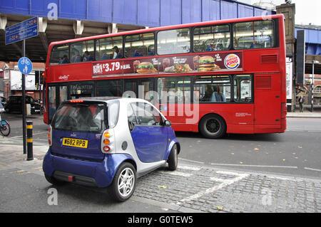 Smart car and London bus, London, England, UK - Stock Image