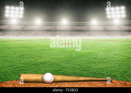Baseball bat and ball on field at brightly lit outdoor stadium. Focus on foreground and shallow depth of field on background and copy space. - Stock Image