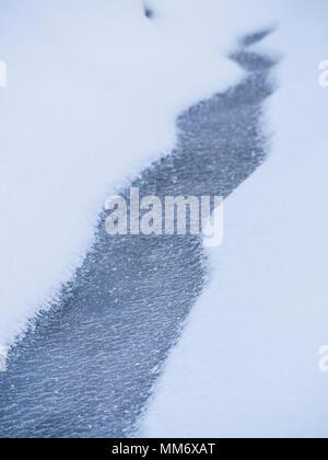 Frozen little river, Valley of Yach, Elzach, Black Forest, Baden-Württemberg, Germany - Stock Image