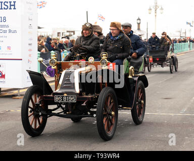 Mr Cliff Jowsey driving his 1902 Renault, across the finishing line in the 2018 London to Brighton Veteran Car Run - Stock Image