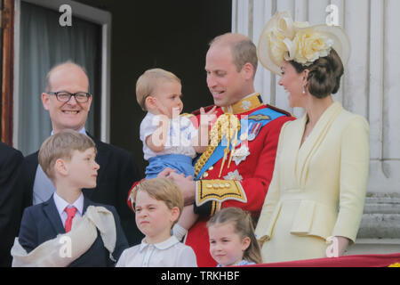One year old Prince Louis steals the show on his debut public engagement.Appearing on the Buckingham Palace balcony, to watch the fly-past with his parents, TRH The Duke and Duchess of Cambridge, and his siblings, Prince George and Princess Charlotte. Trooping the Colour, The Queen's Birthday Parade, London, UK Credit: amanda rose/Alamy Live News - Stock Image