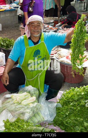 Nakhon SI Thammarat, Thailand-February 11th 2015.  A vegetable vendor on the market. The market is open every morning. - Stock Image
