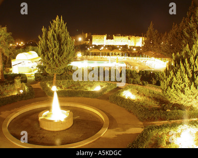 Swimming pool with the roman theatre in background in Bosra - Stock Image