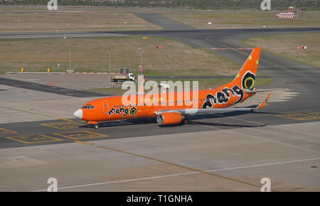 Mango airlines plane taxi on runway. View of full plan and logo at airport in Cape Town , South Africa - Stock Image