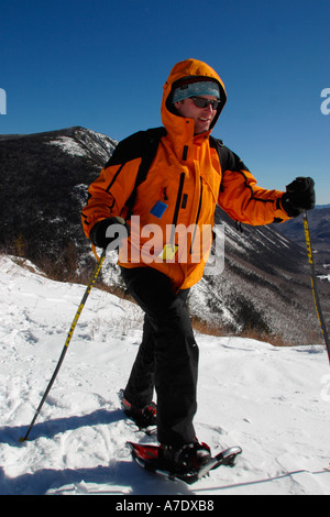 Man Snoweshoeing Crawford Notch New Hampshire Model Release - Stock Image