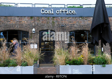 Coal Office Restaurant serving Middle Eastern food entrance exterior view and sign at Coal Drops Yard  Kings Cross London UK  KATHY DEWITT - Stock Image