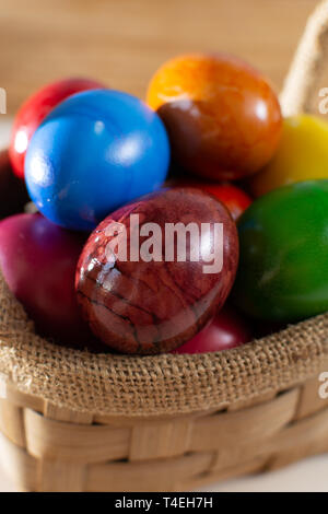 Cooked chicken eggs for Ester celebration dinner, colorful painted with organic paint ready to eat close up - Stock Image