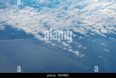 Blue sky high view from airplane clouds - Stock Image