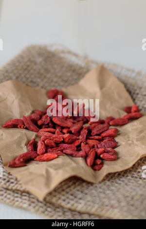 Goji Berries on white wooden background. Wolfberry close-up - Stock Image