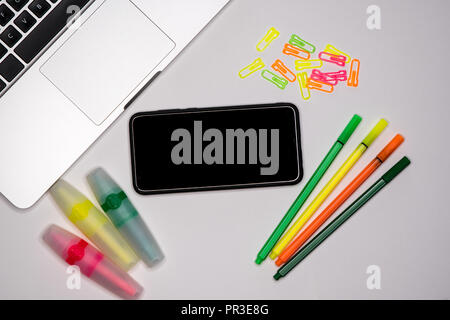 Smartphone with text space, copy space on desktop. School concept. - Stock Image