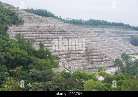 Terraced tombs at Tseung Kwan O Chinese Permanent Cemetery, Hong Kong - Stock Image
