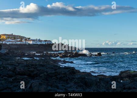 View along the coastline of Playa San Juan, Tenerife, Canary Islands, Spain - Stock Image