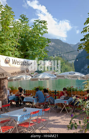 Biergarten at Lake Königsee, Berchtesgaden, Bavaria, Germany, on a sunny and warm summer's day. - Stock Image