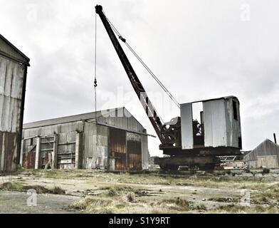 Derelict warehouses and crane in Scottish town. - Stock Image