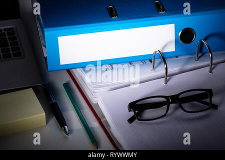 Office Workplace With Laptop And Folders On White Table - Stock Image