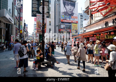 Busy shopping street in Osaka, Japan during the day - Stock Image