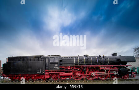 Braunschweig, Germany, December 30., 2018: Steam locomotive in front of the main railway station, coal-fired German locomotive from 1939 - Stock Image