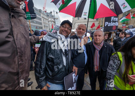 London, UK. 11th May 2019. People wait at the BBC to a rally in Whitehall a few days before Nakba day showing solidarity with the Palestinian people and opposing continued Israel violation of international law and human rights. The protest called for an end to Israeli oppression and the siege of Gaza and for a just peace that recognises Palestinian rights including the right of return. It urged everyone to boycott and divest from Israel and donate to medical aid for Palestine. Peter Marshall/Alamy Live News Credit: Peter Marshall/Alamy Live News - Stock Image