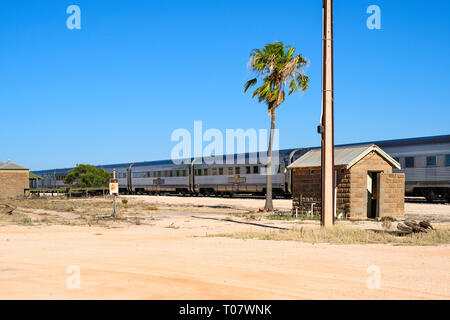 The Indian Pacific train service between Perth and Sydney, Australia, is seen at a stop at Rawlinna, Western Australia. - Stock Image