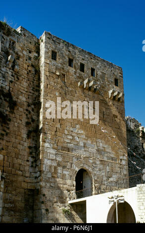 Syria. Talkalakh District, Krak des Chevaliers. Crusader castle, under control of Knights Hospitaller (1142-1271) during the Crusades to the Holy Land, fell into Arab control in the 13th century. Entrance tower. Photo  taken before the Syrian Civil War. - Stock Image