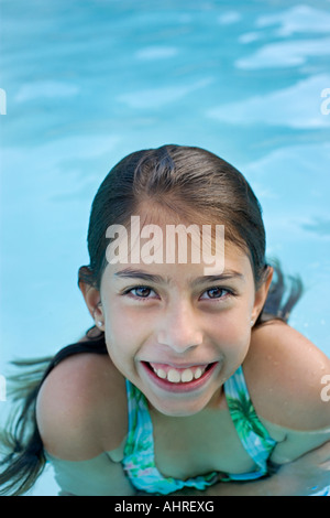 young latin girl in the swimming pool - Stock Image