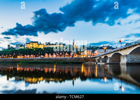Chinon town located in the heart of the Val de Loire, France during the blue hour . Well known for its wines, castle and historic town. Popular touris - Stock Image