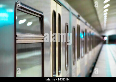 Subway train stopped at the station without people - Stock Image