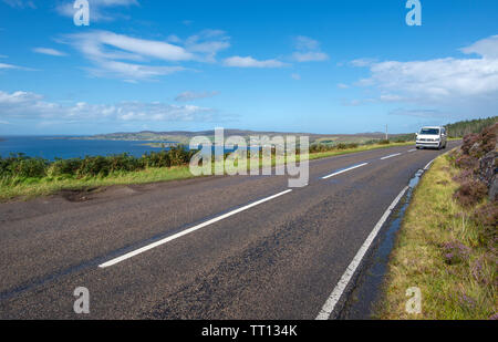 Car driving along the North Coast 500 scenic route near Laide in Wester Ross, Scotland, UK - Stock Image