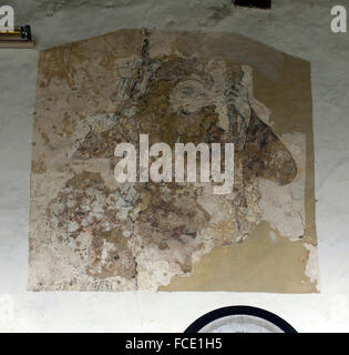 Medieval wall painting depicting St Christopher carrying the infant Jesus across a river, north wall of nave in - Stock Image