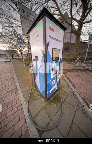 Braunschweig, Germany, December 30., 2018: Electric charging station for charging the weak batteries of electric cars, near the main railway station - Stock Image