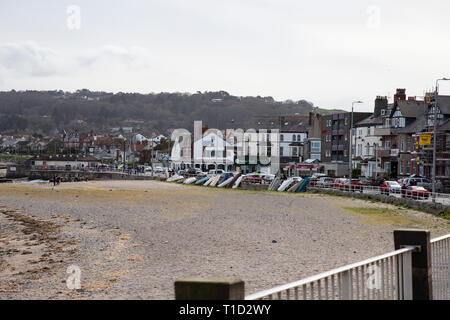 Shops and promenade at Rhos on Sea, North Wales viewed from Rhos point. - Stock Image
