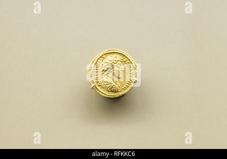 Merida, Spain - August 25th, 2018: Gold coin of Marcus Aurelius Roman Emperor at National Museum of Roman Art in Merida, Spain - Stock Image