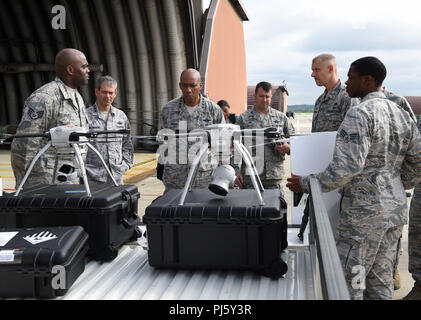 Airmen from the 51st Civil Engineer Squadron operations engineering flight brief Gen. CQ Brown, Jr., Pacific Air Forces commander, on the Skyranger Unmanned Aircraft Vehicle system at Osan Air Base, Republic of Korea, Aug. 29. 2018. This system enhances civil engineering's airfield damage assessment capabilities by speeding up processes and keeping Airmen's lives out of danger. (U.S. Air Force photo by Staff Sgt. Sergio A. Gamboa) - Stock Image