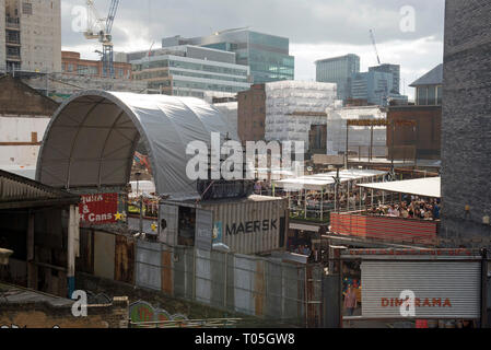 Dinerama pop-up food market with cityscape behind Great Eastern Street, Shoreditch, London Borough of Hackney England Britain UK - Stock Image