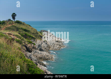 Rocky hills of Promthep Cape on Phuket, Thailand - Stock Image