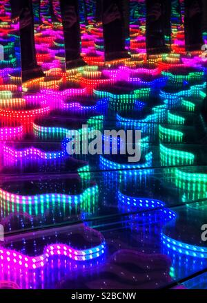 A colourful image showing various lights reflected in multiple mirrors. An image that illustrates colour and infinity. A potential background image? Photo Credit © COLIN HOSKINS. - Stock Image