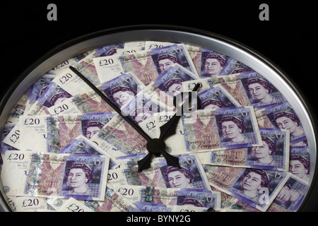 Twenty Pound Notes on Clock Face with Hands - Stock Image