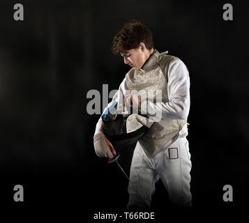 Teenage boy fencing - Stock Image