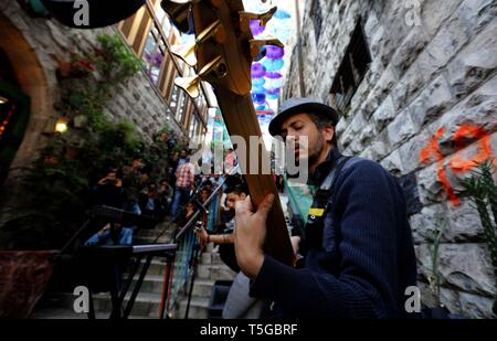 Amman, Jordan. 24th Apr, 2019. Yacoub Abu Ghosh, a Jordanian composer and performer, performs at a free street concert near Shamasi stairs, downtown Amman, Jordan, on April 24, 2019. The 8th Amman Jazz Festival is held here between April 19 and 25. Credit: Mohammad Abu Ghosh/Xinhua/Alamy Live News - Stock Image