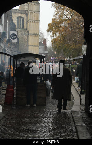 Rochester, Kent, UK. 1st December 2018: A man in Victorian period costume walk up Boley Hill towards Rochester cathedral during the Dickensian Festival. Hundreds of people attended the Dickensian Festival in Rochester on 1 December 2018. The festival's main parade has participants in Victorian period costume from the Dickensian age. The town and area was the setting of many of Charles Dickens novels and is the setting to two annual festivals in his honor. Photos: David Mbiyu/ Alamy Live News - Stock Image
