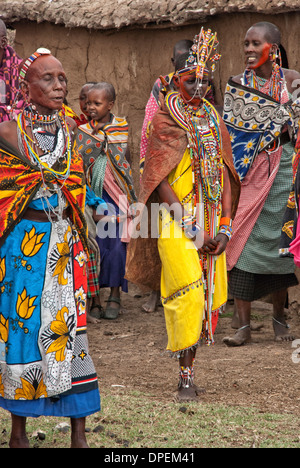 Bride attired in wedding dress, jewelry and facial color for an enactment of a Masai wedding in a Village, Masai Mara, Africa - Stock Image