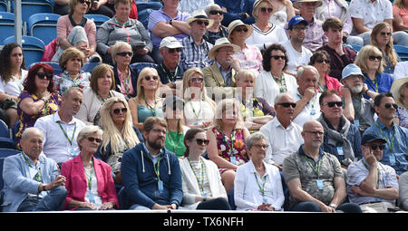 Eastbourne, UK. 24th June, 2019. The crowd watch Fernando Verdasco of Spain in action against John Millman of Australia during their match at the Nature Valley International tennis tournament held at Devonshire Park in Eastbourne . Credit: Simon Dack/Alamy Live News - Stock Image