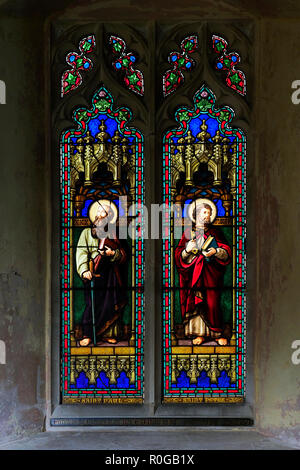 The Victorian stained glass memorial window to Revd Neale erected in 1871 and showing Saints Peter and Paul. - Stock Image