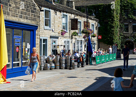 People drinking outside the Shoulder of Mutton pub, Hebden Bridge, West Yorkshire, England UK - Stock Image