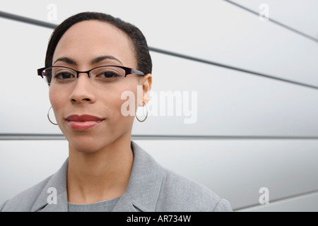 African businesswoman wearing eyeglasses - Stock Image