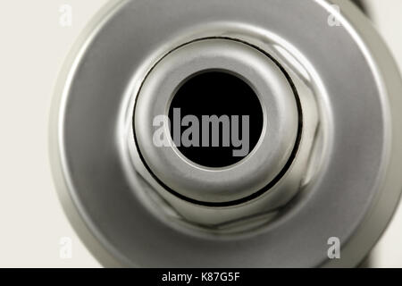 A 'guess what it is', close up image of a garden spray head showing the hose connector end - Stock Image
